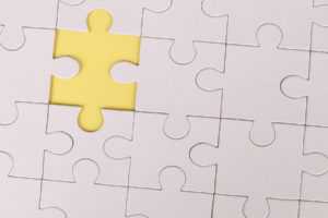 Jigsaw Puzzle with one yellow piece